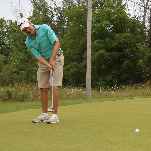 golfer practices on putting green at bruces mill conservation park driving range
