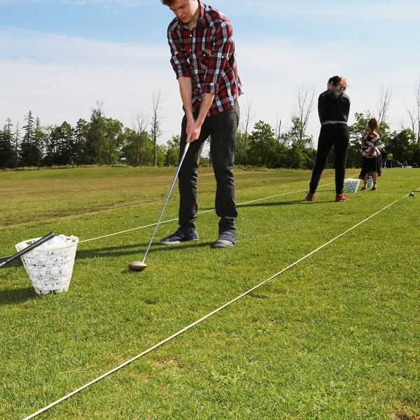 golfers practice on driving range at bruces mill conservation park