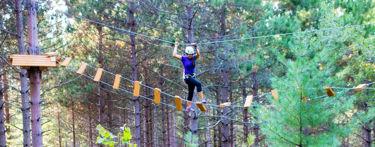 young woman on treetop trekking course at bruces mill conservation park