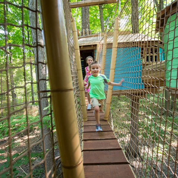children explore treewalk village at bruces mill conservation park