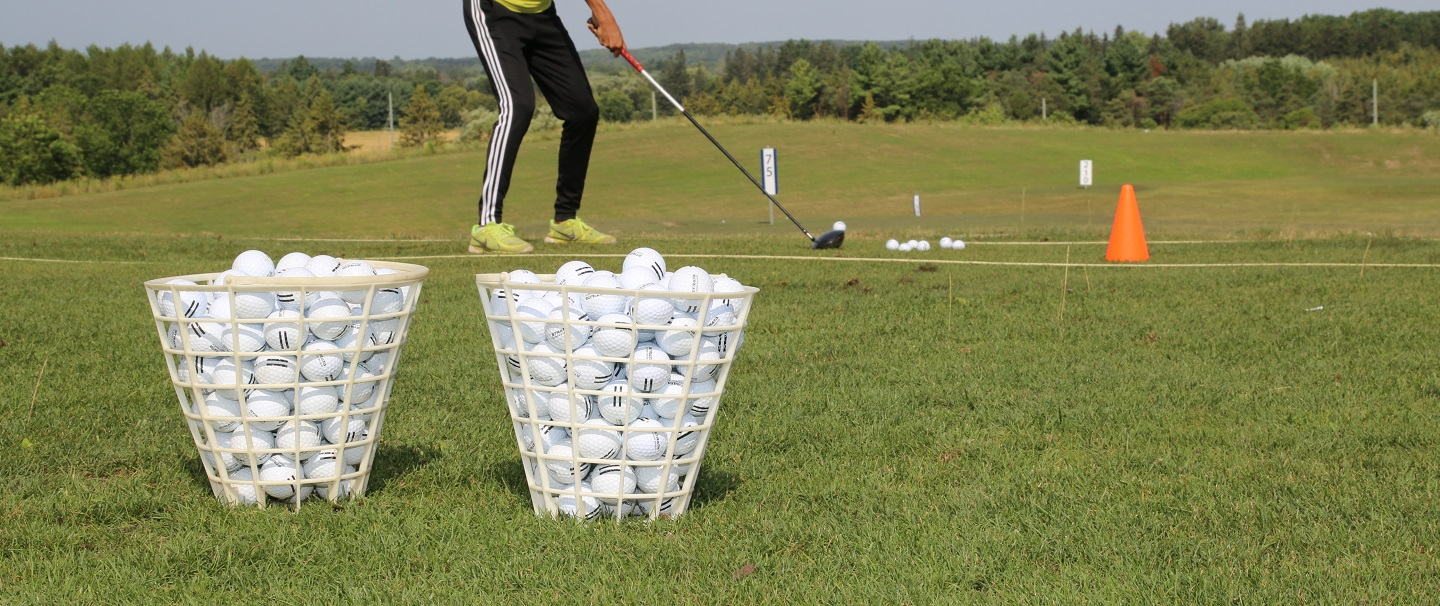 golfer practices swing at bruce's mill driving range