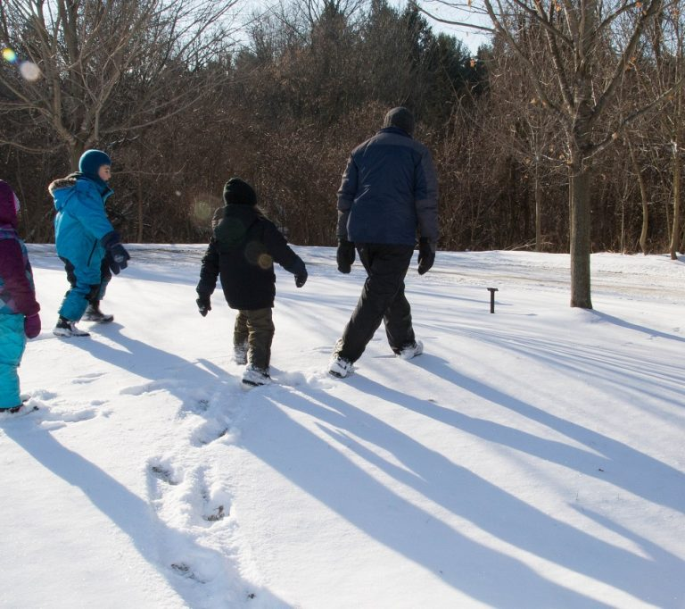 teacher and students at Kortright Centre in winter