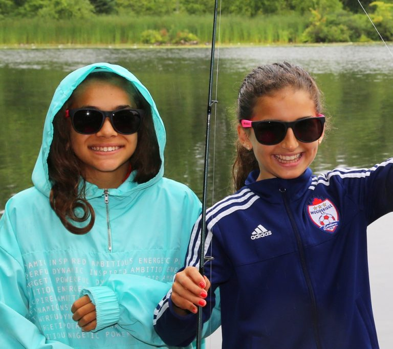 two friends fishing at Heart Lake Conservation Park