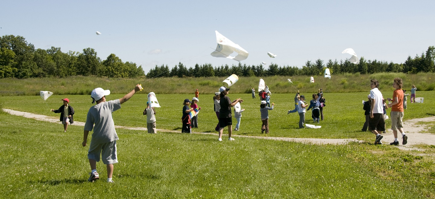 students fly kites at Kortright Centre