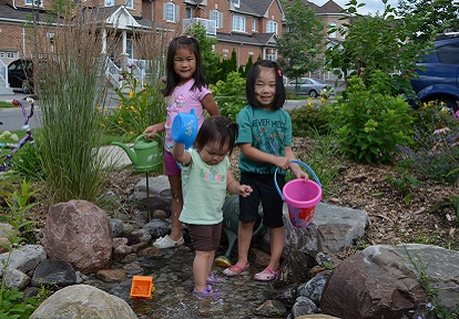Children enjoy Front Yard Makeover at 95 Wheelwright Drive