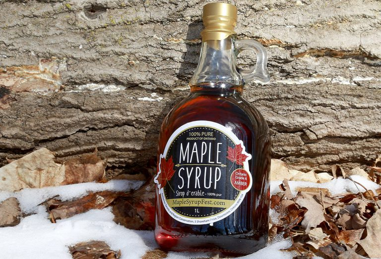 bottle of maple syrup on the ground