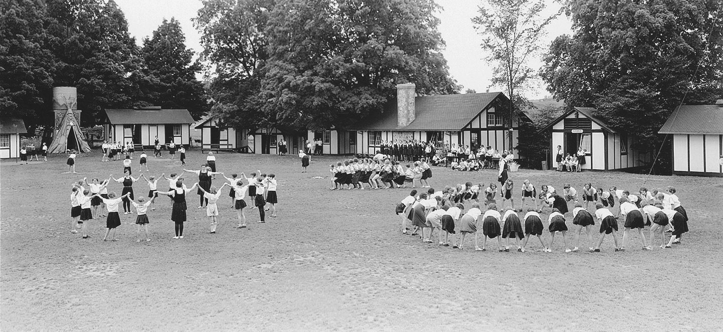 archival image of children playing at Bolton Camp