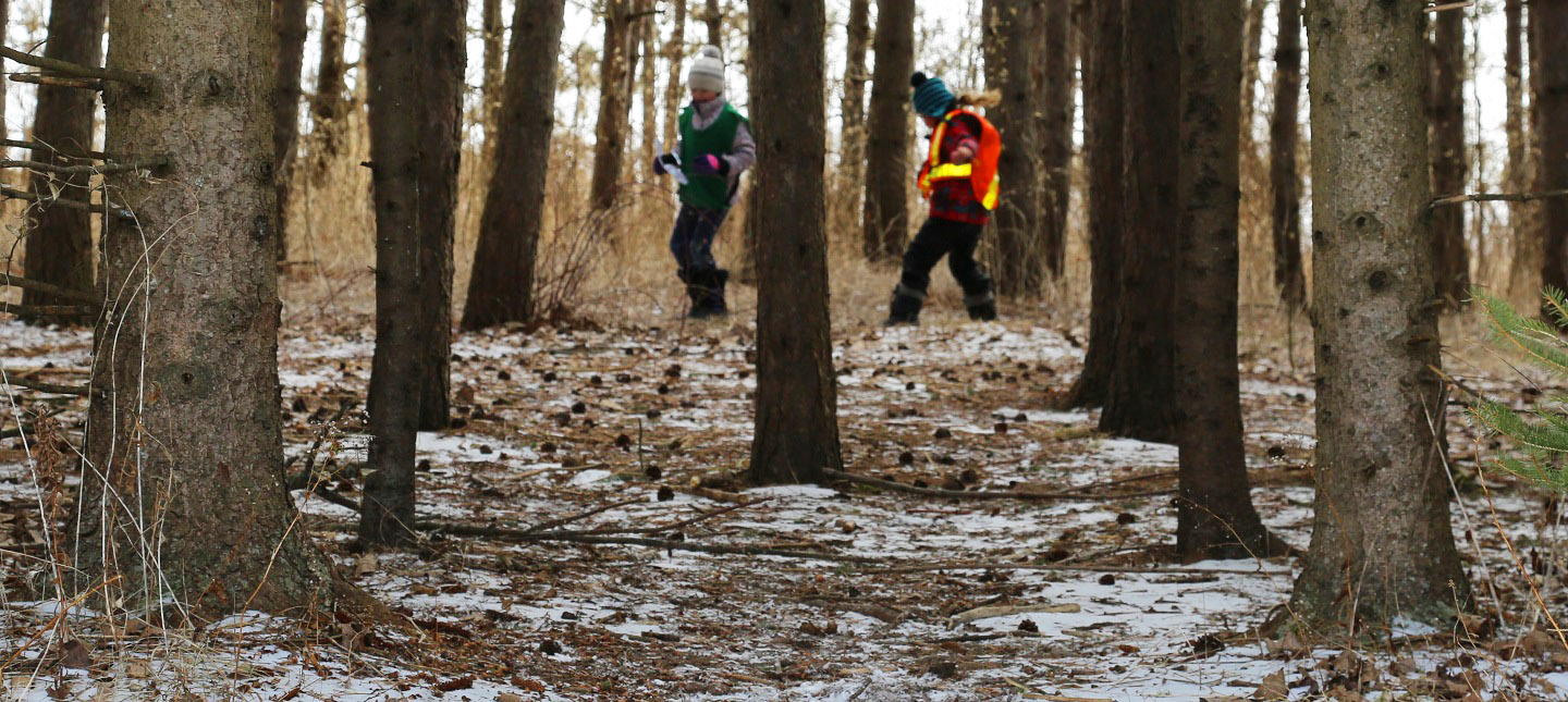 youngsters explore woods at March Break nature camp