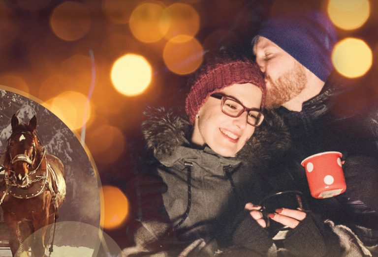 young couple enjoy hot drinks outdoors at Christmas