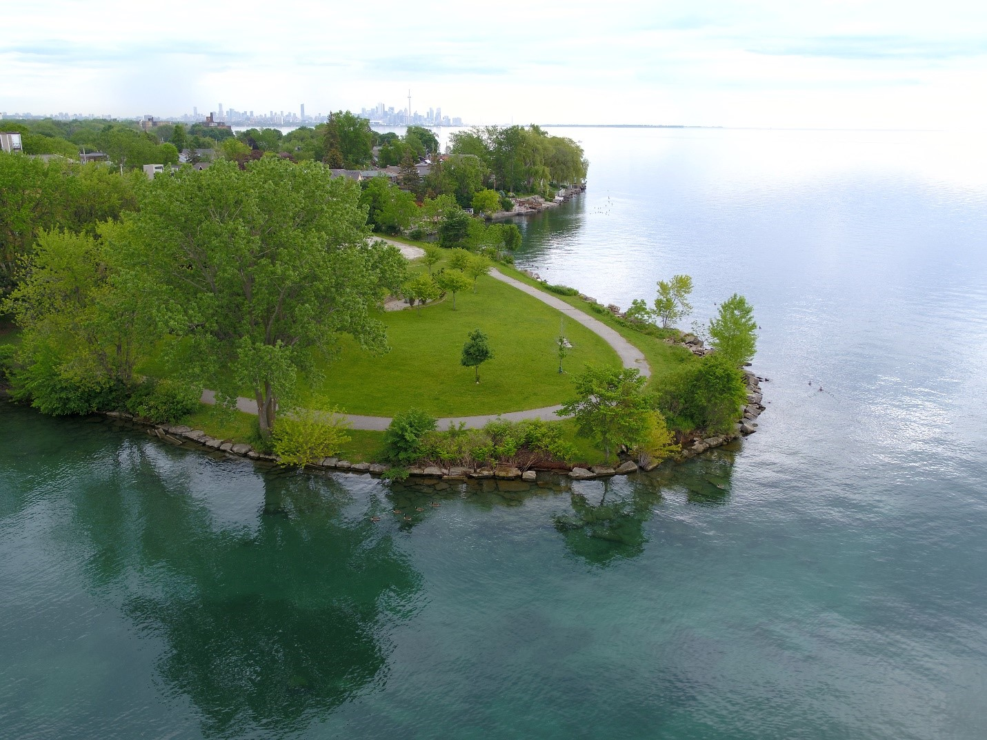 Record high water level of Lake Ontario in June 2017, causing further erosion of the Rotary Peace Park headland. Source: TRCA, 2017.
