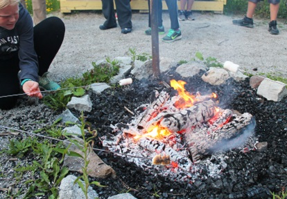 boy toasting marshmallows over campire at Albion Hills Field Centre
