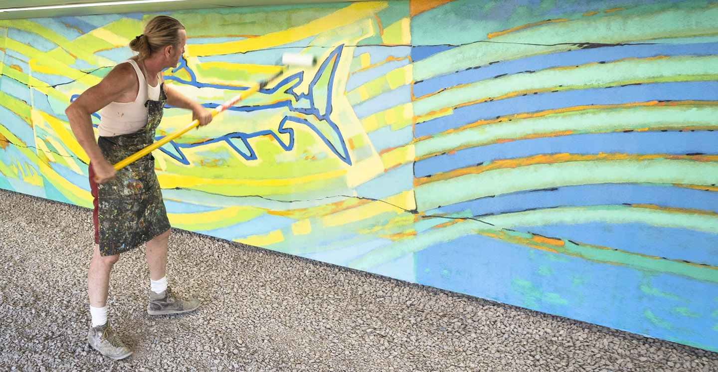 artist Bill Wrigley works on Don River mural