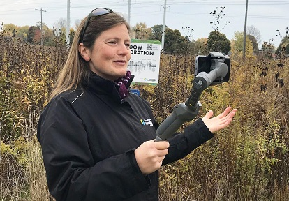 TRCA educator leads Watershed on Wheels Nature in Your Classroom livestream session from restored meadow area using mobile phone and selfie stick