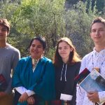 Indigenous teens pose with Elder Whabagoon at eagle feather ceremony
