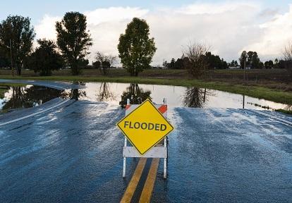 flood warning sign on highway