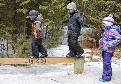 children walk on balance beam at Claremont Nature Centre winter camp