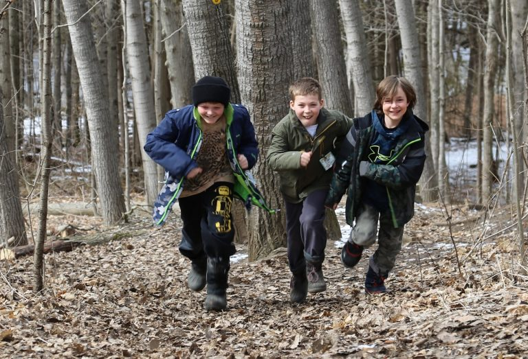 boys running through forest at Claremont Nature Centre