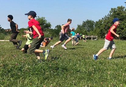 children play outdoors at summer day camp at Claremont Nature Centre
