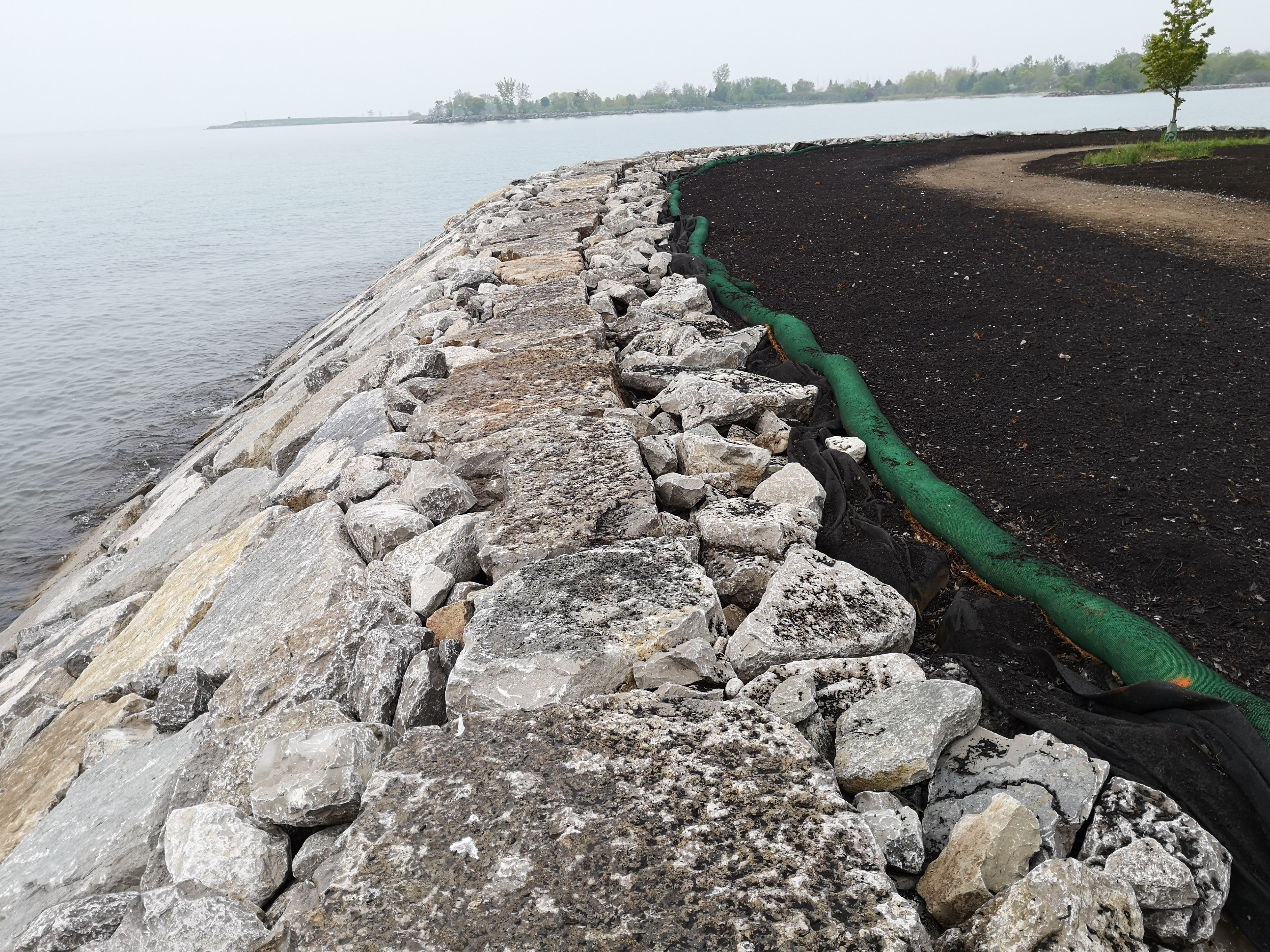 Completed erosion control structure with disturbed area behind under restoration. Source: TRCA, 2019.