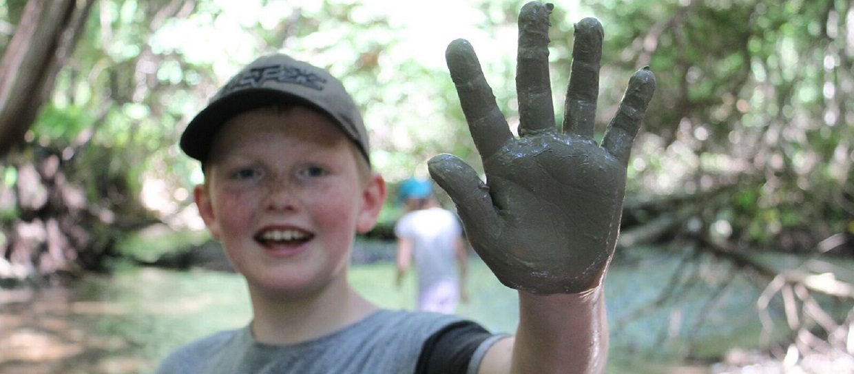 boy takes part in Forest Explorers Nature Club at Claremont Nature Centre