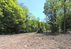 Removed soil stockpile and continued trail realignment.