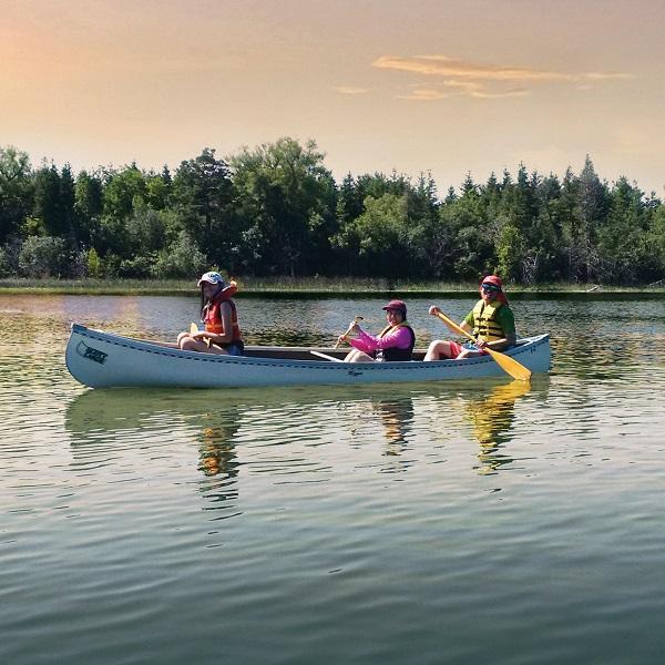 paddlers on Lake St George at dusk