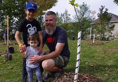 father and children at West Bolton SNAP neighbourhood planting event