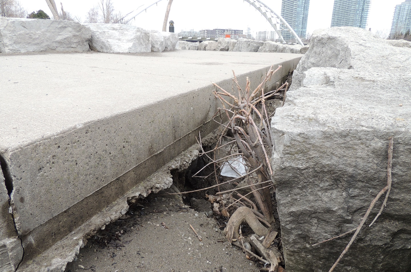 displacement of stones beneath concrete slabs at Humber Bay Shores