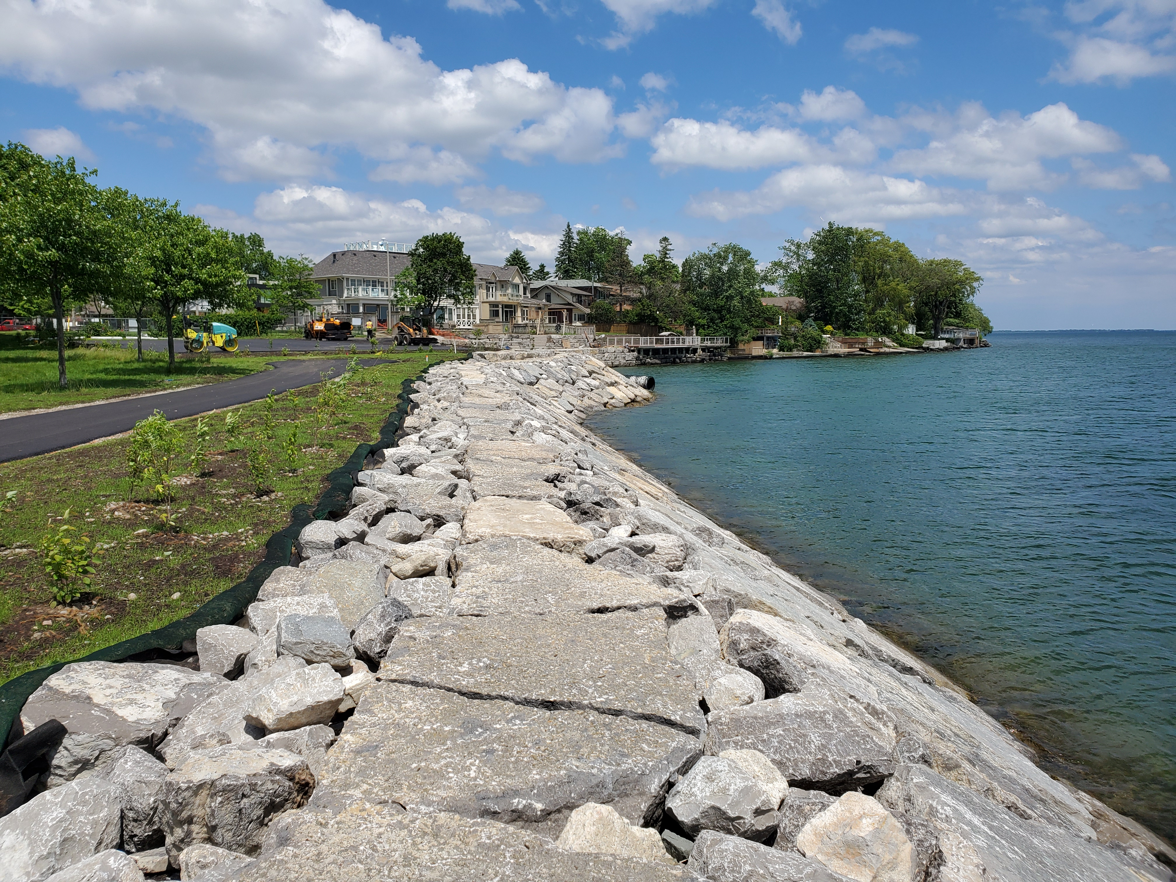 Repaired revetment with rip rap splash apron and planted swale. Source: TRCA, 2019.