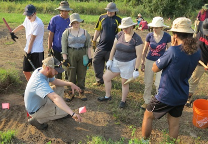 instructor speaks to students at Boyd Archaeological Field School