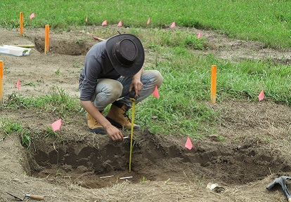 student works on excavation at Boyd Archaeological Field School