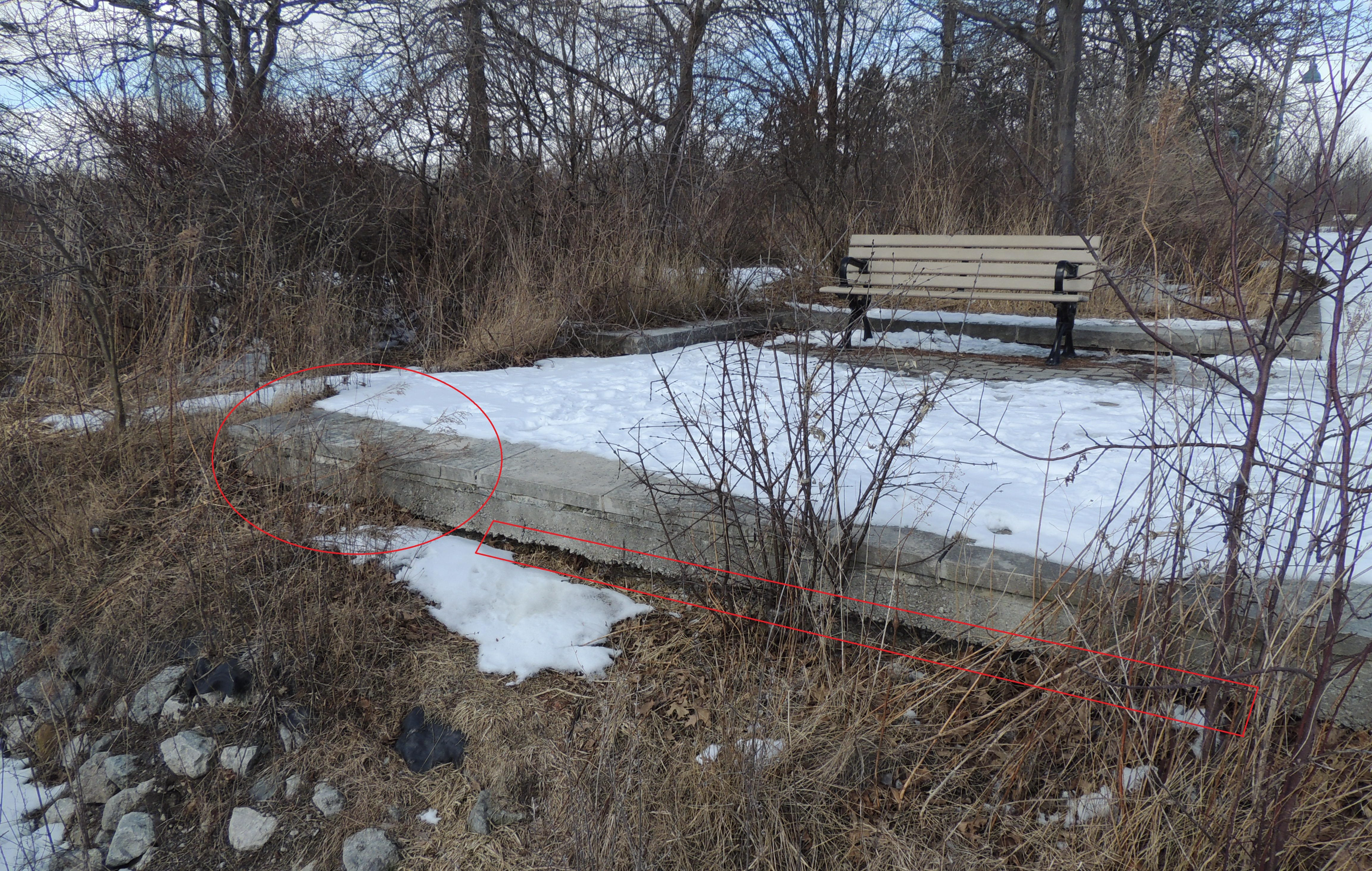 Undermined interlocking brick platform adjacent to the armourstone seawall. Source: TRCA, 2019.