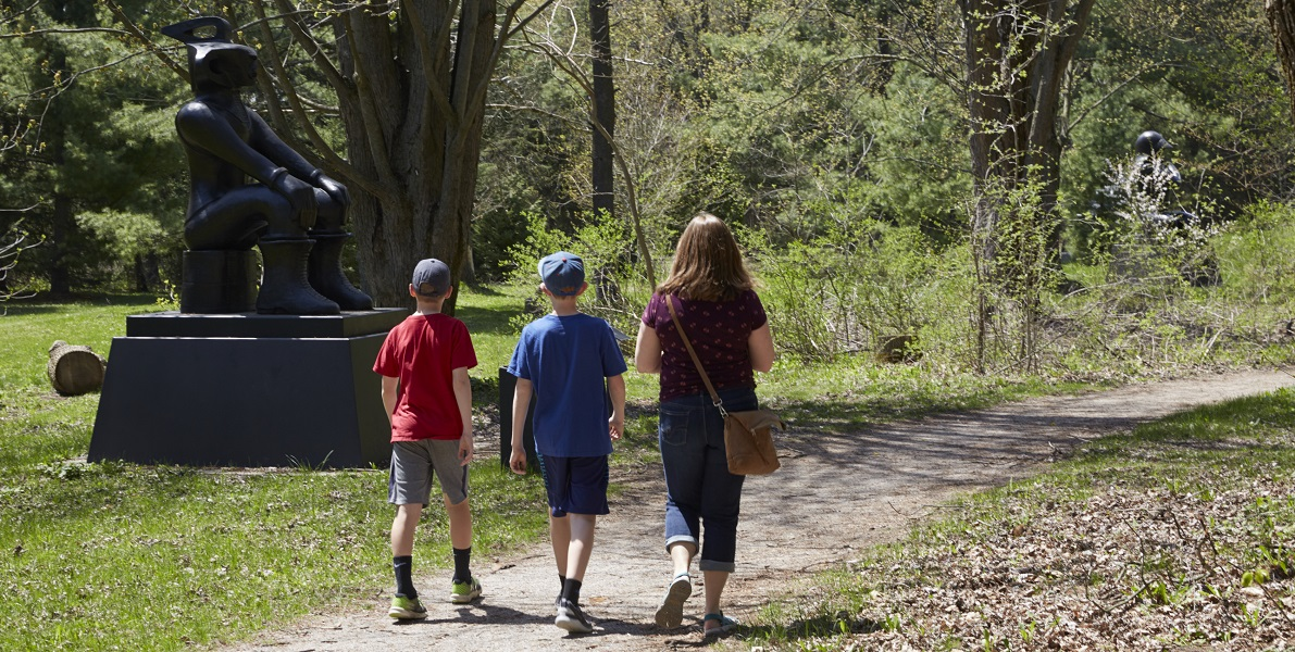Family walking along a trail