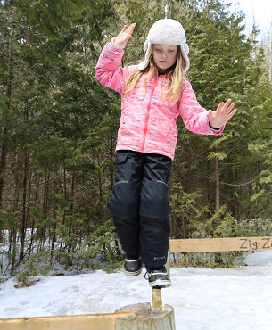 girl practices wilderness survival activities during March Break camp at Claremont Nature Centre