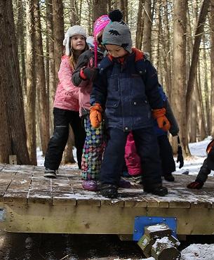 children practice balance exercise at Claremont Nature Centre winter camp