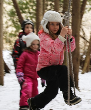 girl swings on low ropes at Claremont Nature Centre