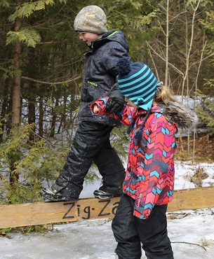 boy and girl practice balance exercise at Claremont Nature Center March Break camp