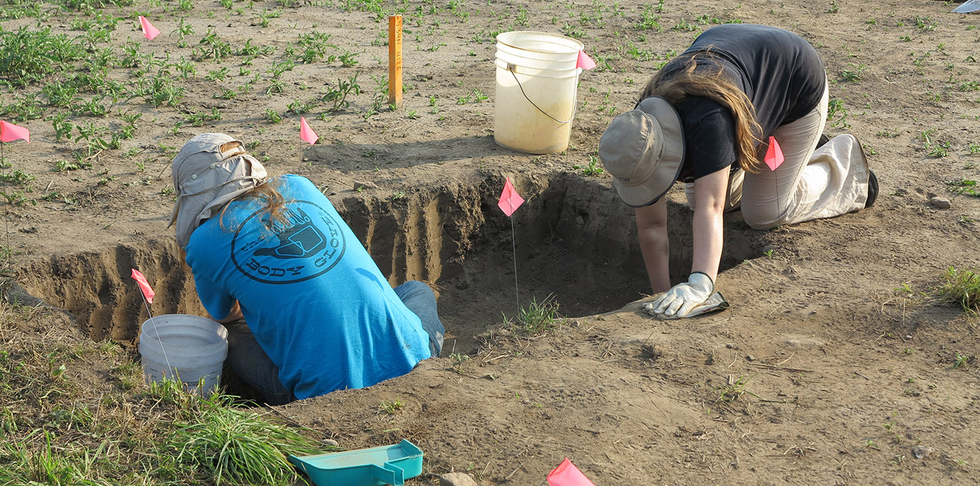 Boyd Archaeological Field School students work on excavation at dig site