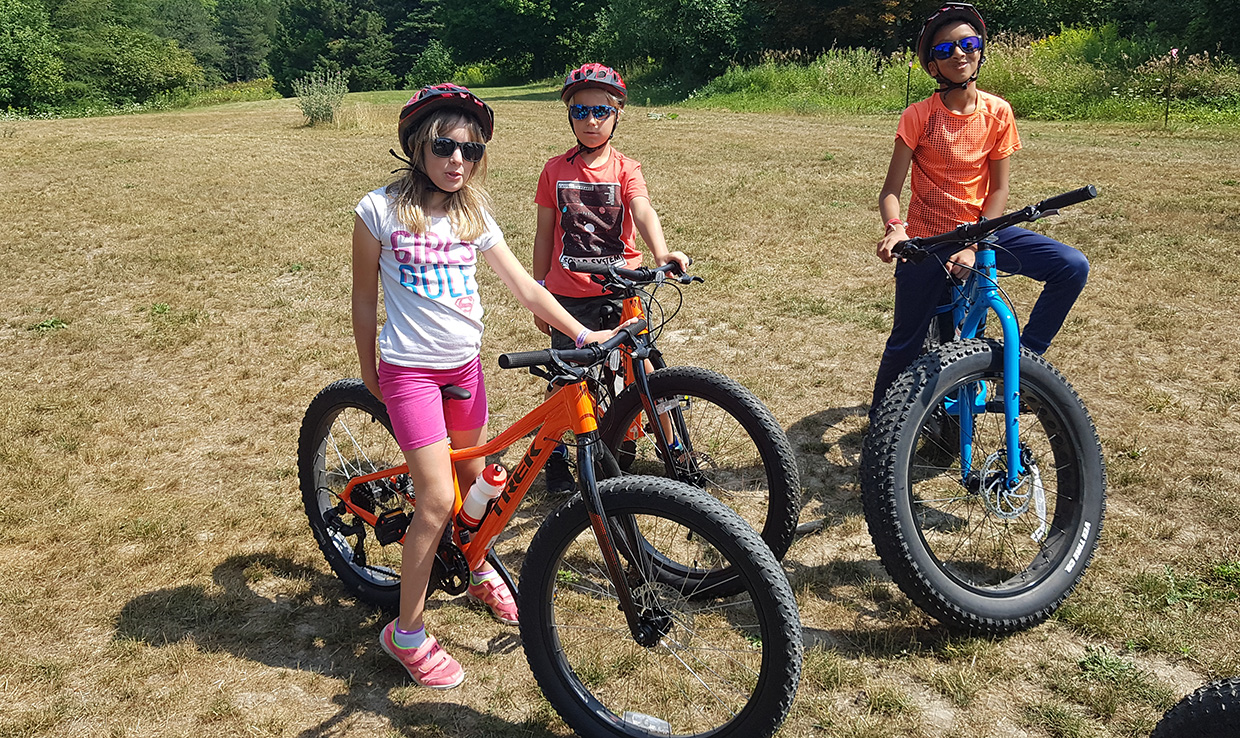 youngsters ride fat-tire bikes at Albion Trails summer camp