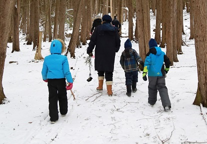 children walk in forest at Lake St George March Break nature camp