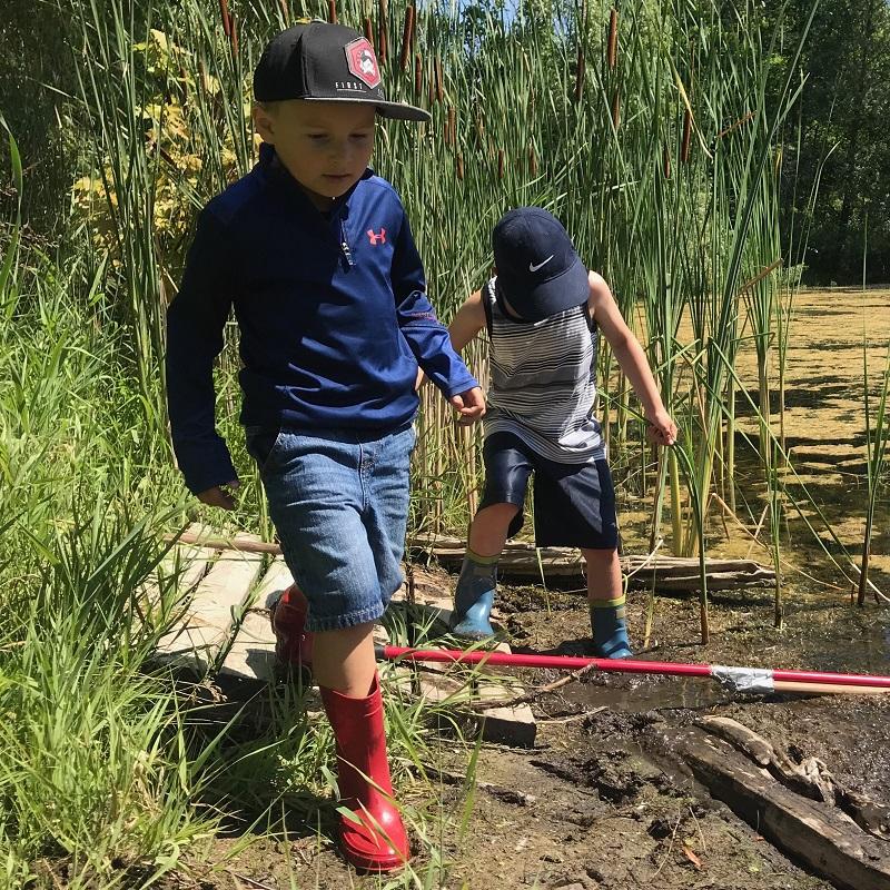 summer campers walk along edge of Lake St George