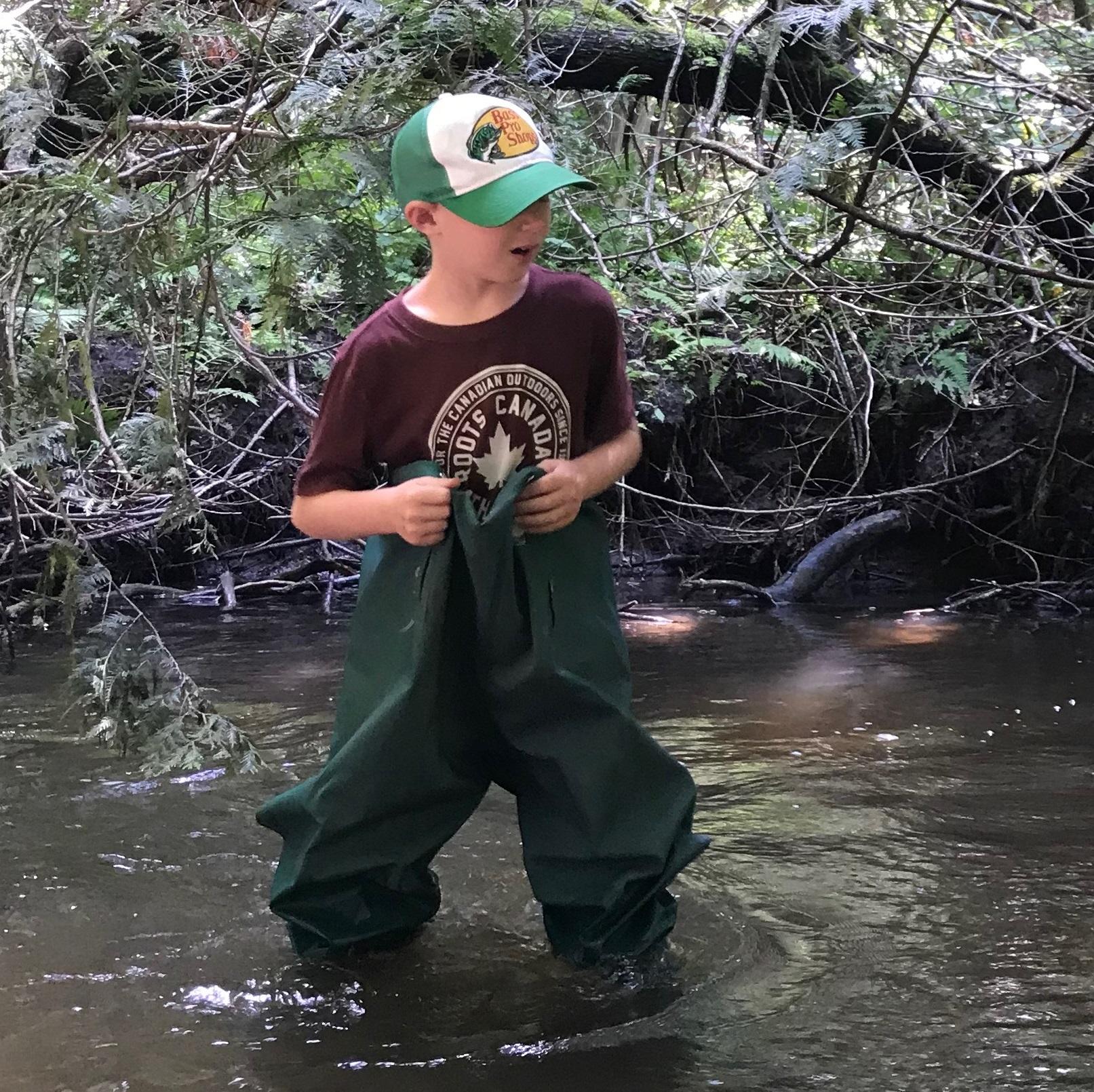 camper explores stream at Claremont Nature Centre