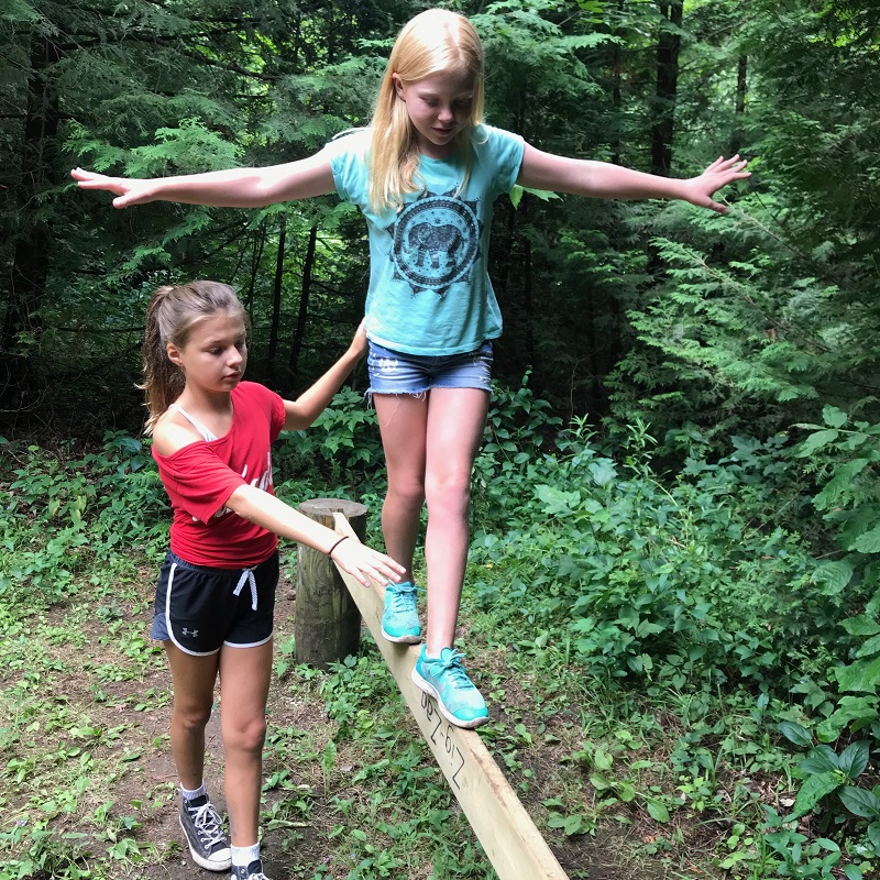 campers practice walking on balance beam at Claremont Nature Centre