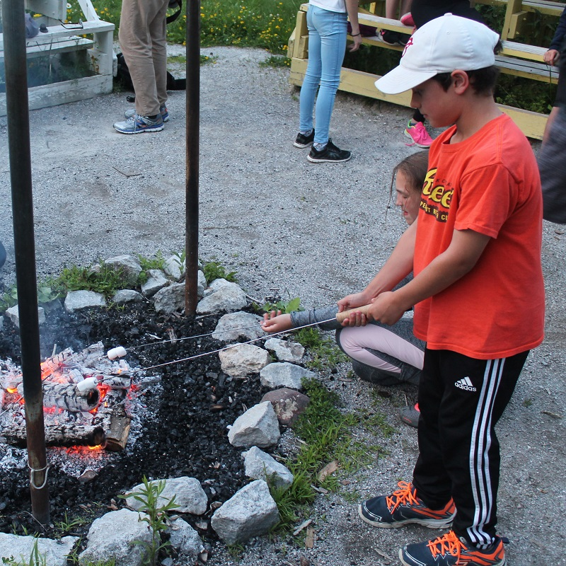 summer campers roast marshmallows at Albion Hills Field Centre