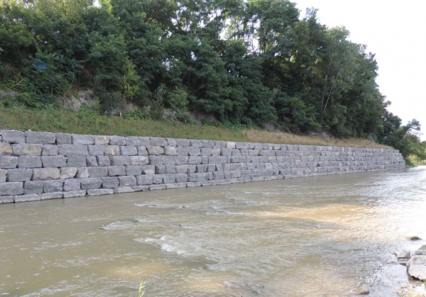 An armourstone wall along the bank of the Humber River
