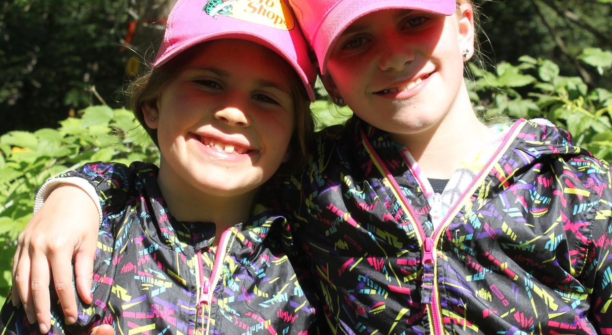 two girls in matching jackets pose for photograph at Claremont Nature Centre PA day camp