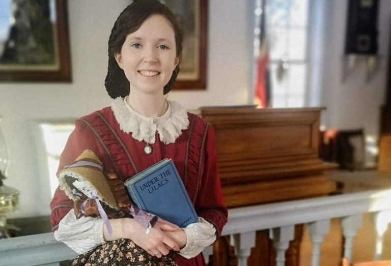 Pioneer woman holding a book