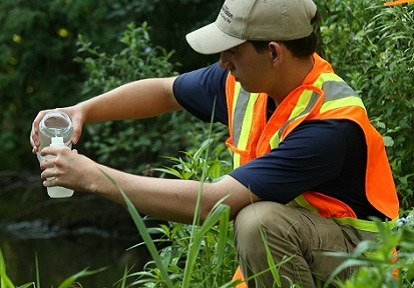 TRCA staff member conducts water sampling