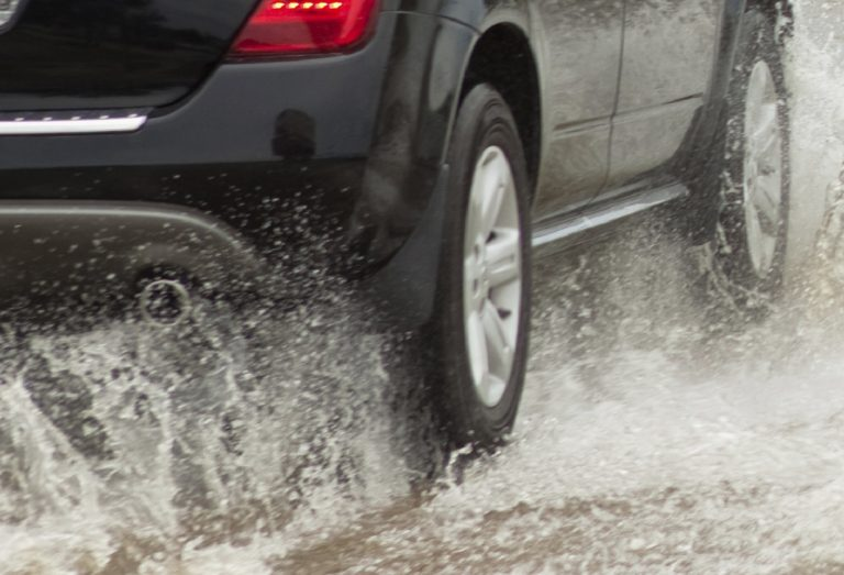 image of car driving through flooded streets highlights the importance of emergency preparedness week