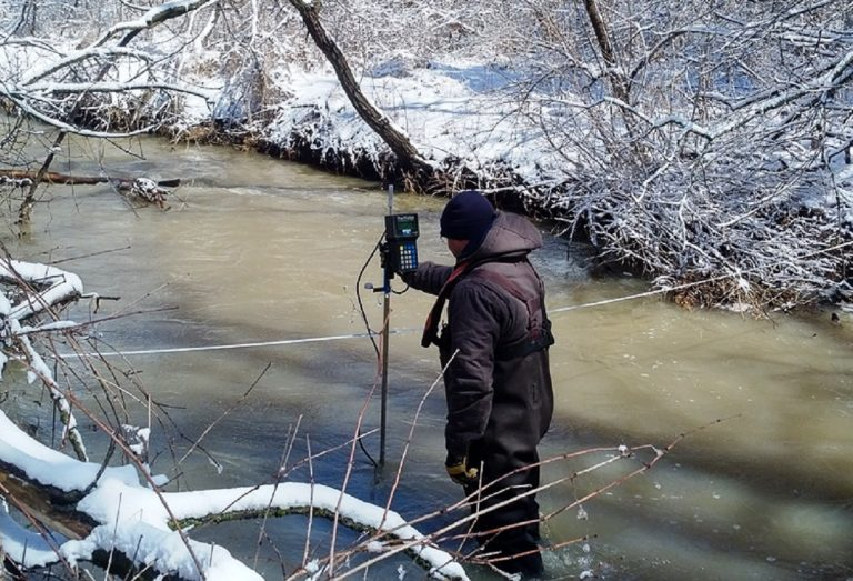 TRCA team member measures stream water levels during winter